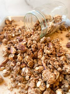 protein granola spilling out of jar
