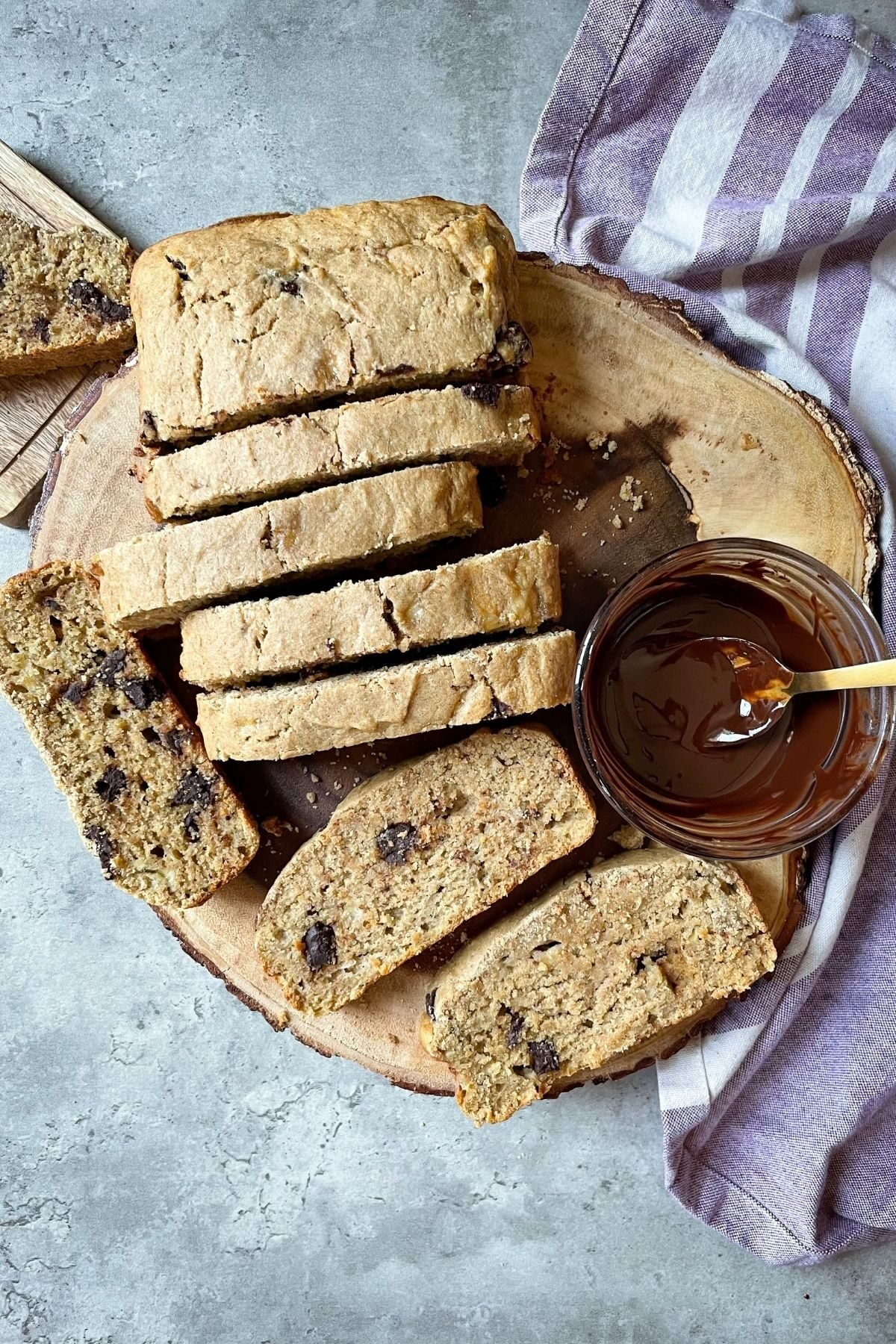 banana bread on wooden board with chocolate