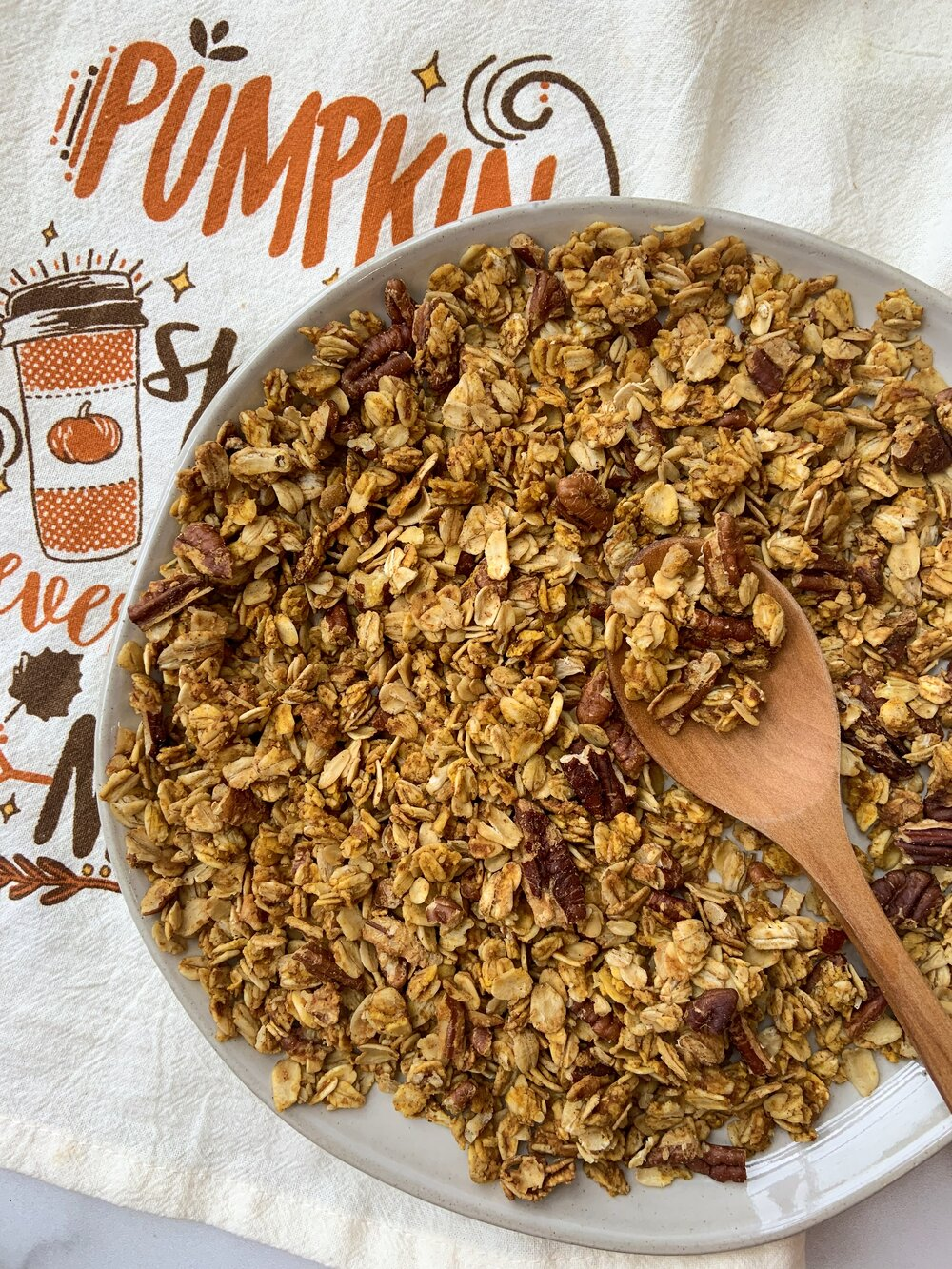 Pumpkin Spice Granola - Homemade granola is best for a few reasons. You can control the ingredients you add in, you can create flavor combinations that cannot be found in stores and you can prep a mason jar full to have on hand during the week. Try out this low-sugar, gluten-free Pumpkin Spice Granola to pair with your next yogurt bowl!