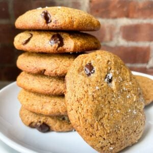 stacked cookies on plate with brick background