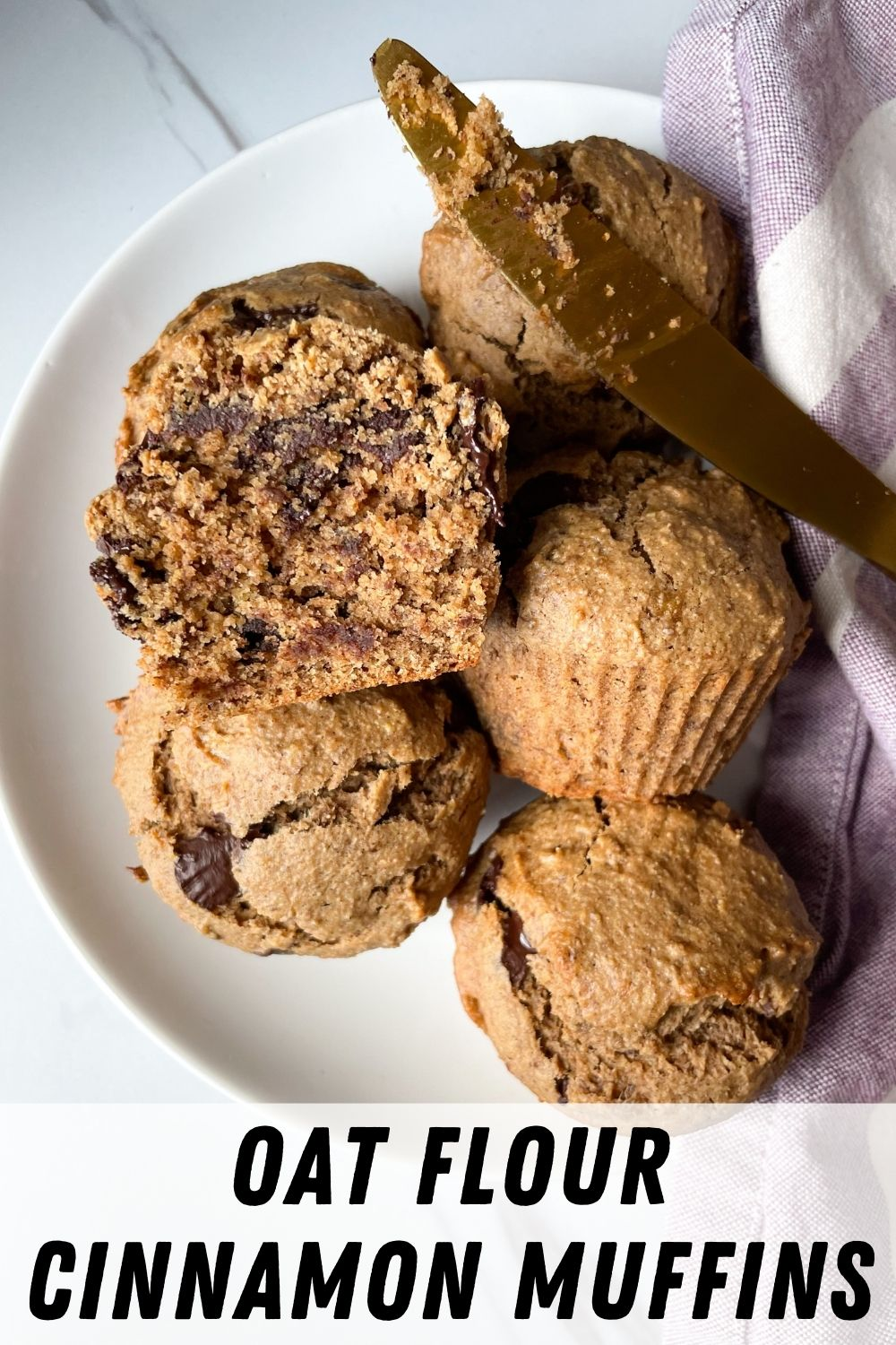 oat flour muffins on plate with gold knife