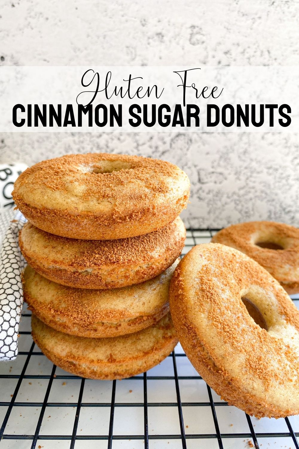 stacked donuts on cooling rack with text overlay