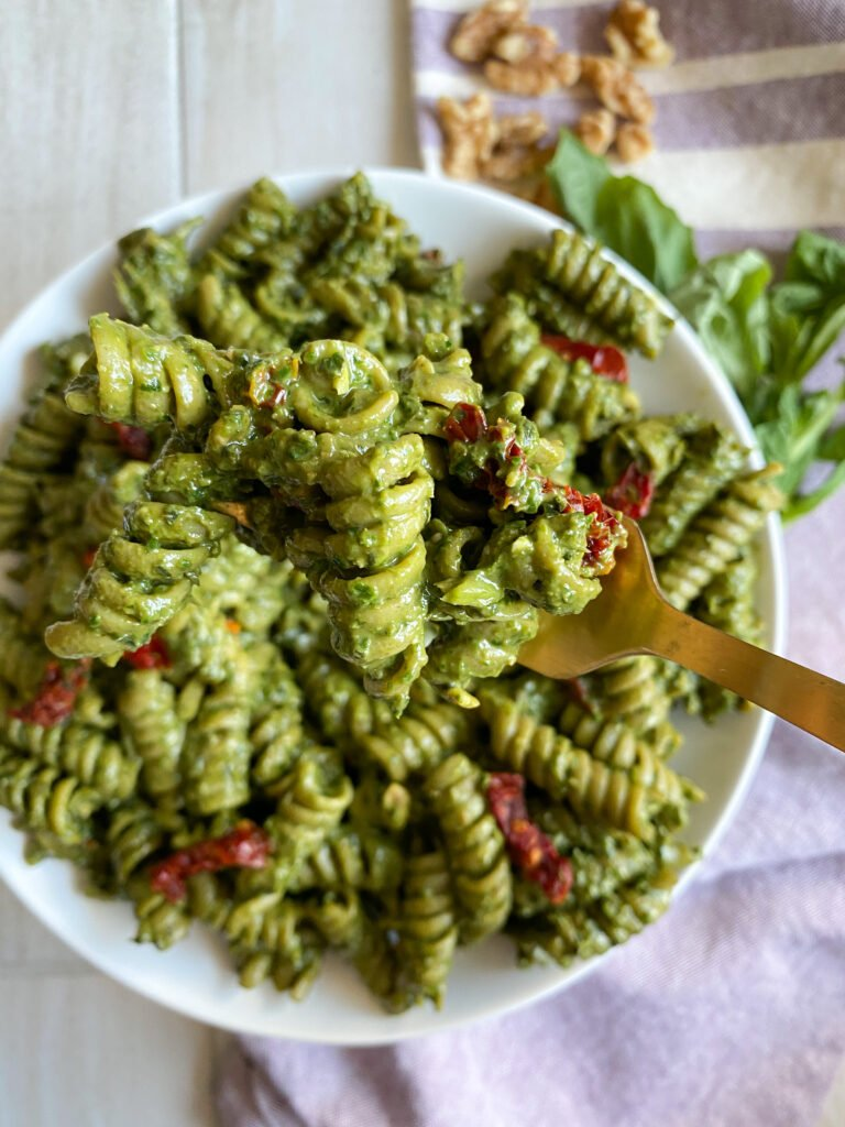 Fork full of pesto pasta