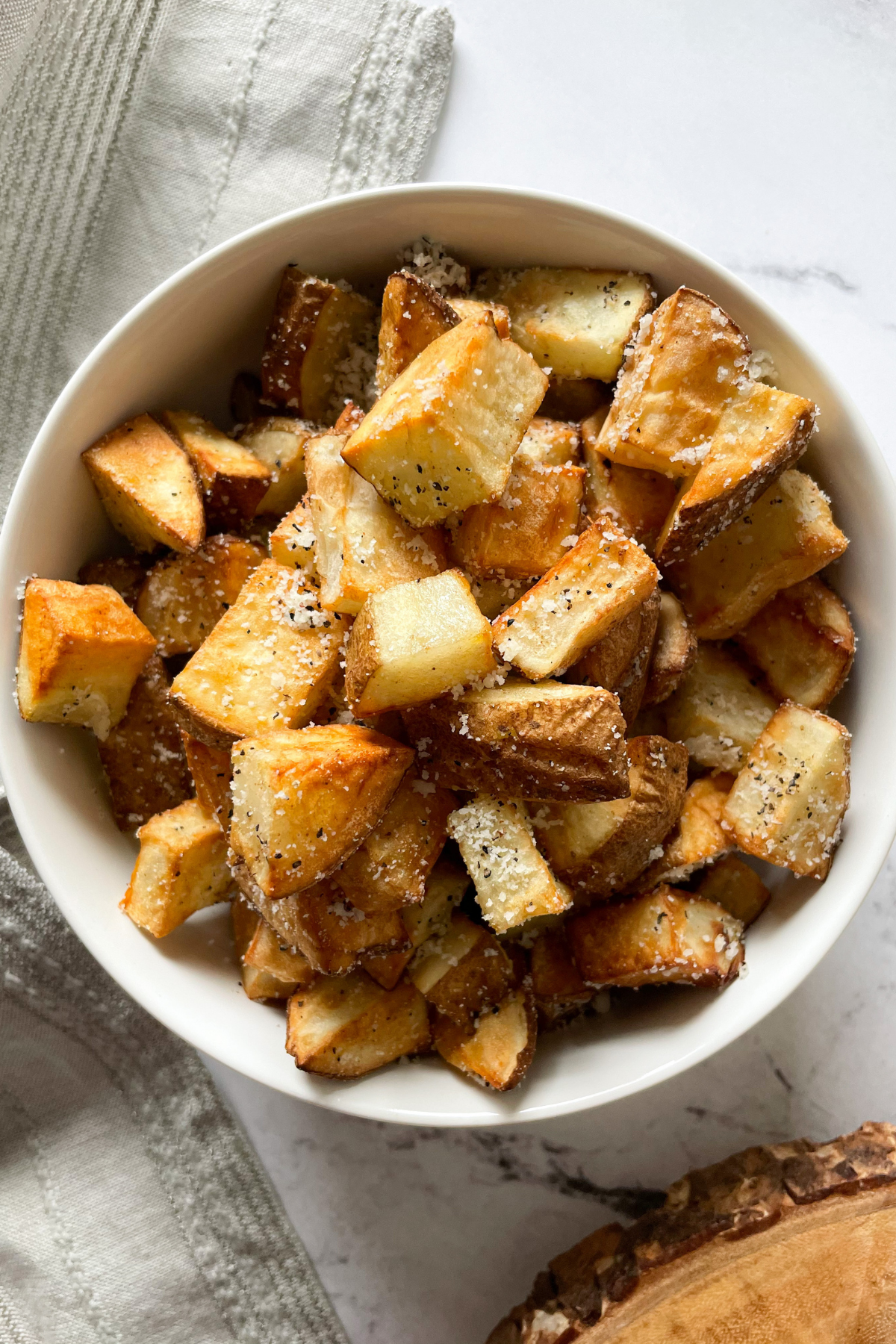 cooked potatoes in a white bowl
