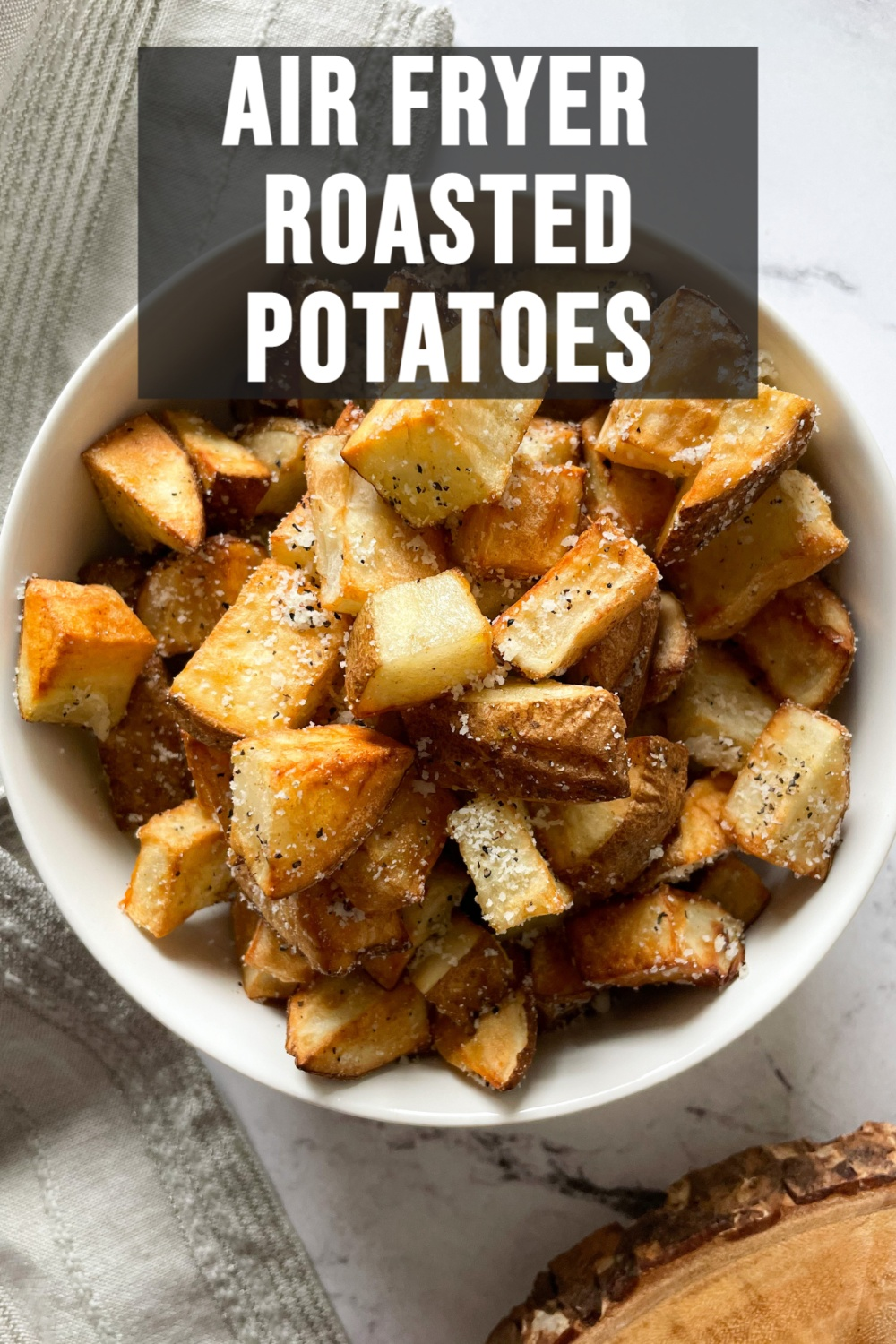 cooked potatoes in a white bowl with text overlay