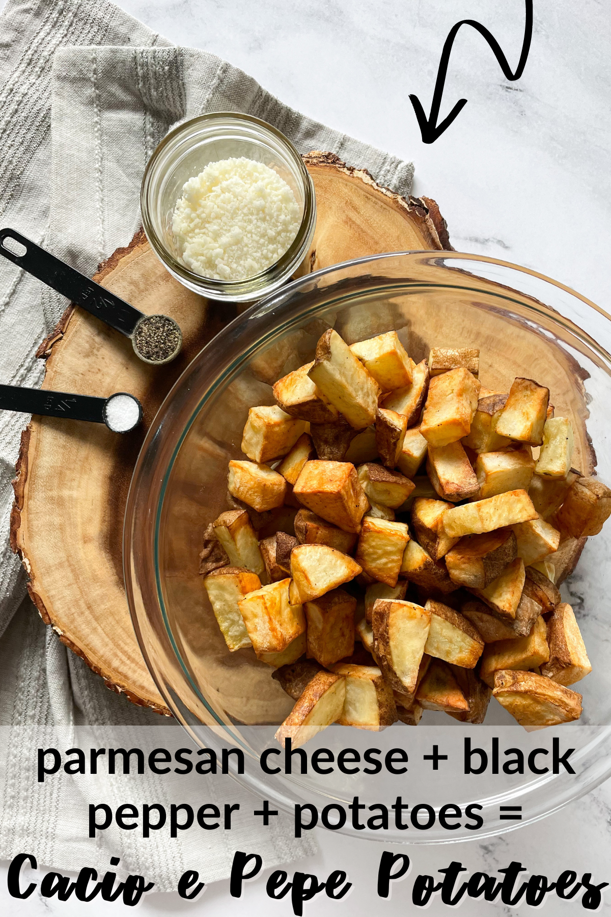 cooked potatoes in a bowl with parmesan cheese, black pepper and salt with text overlay