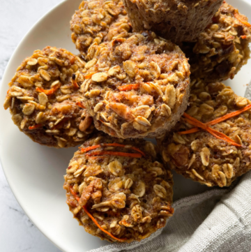 Carrot Cake Baked Oatmeal Cups Stacked on Plate