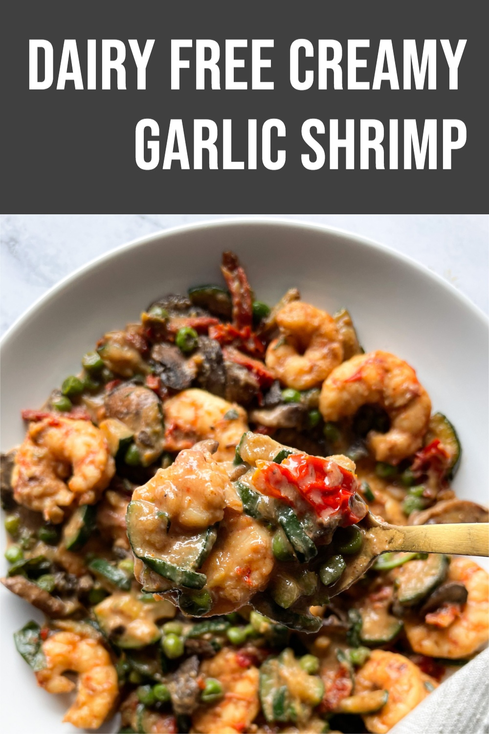 garlic shrimp in plate with gold spoon and text overlay