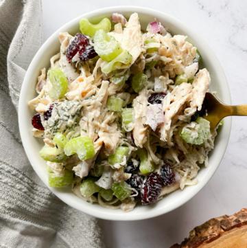Healthy Greek Yogurt Chicken Salad in a bowl with a fork