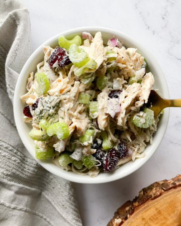 Healthy Greek Yogurt Chicken Salad in a bowl with a fork
