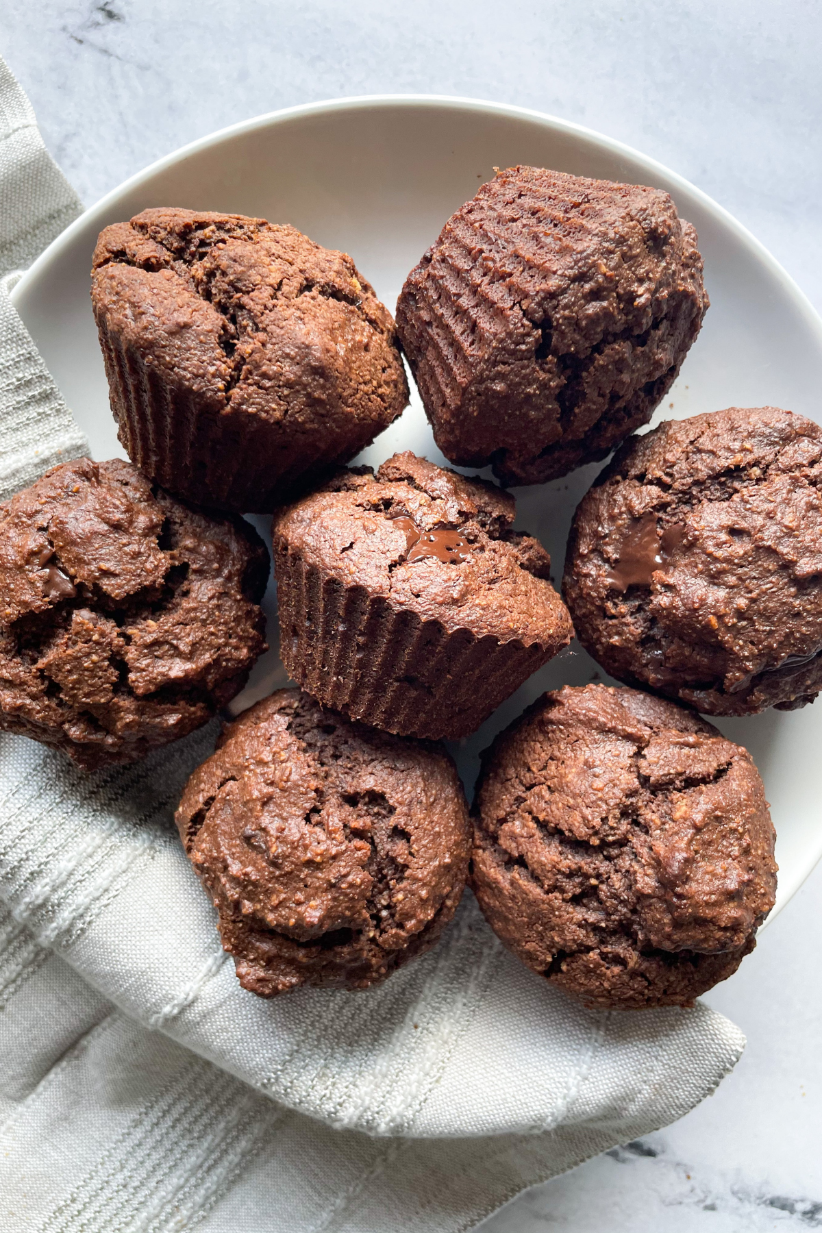 healthy chocolate muffins on white plate