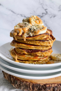 stack of pancakes with toppings