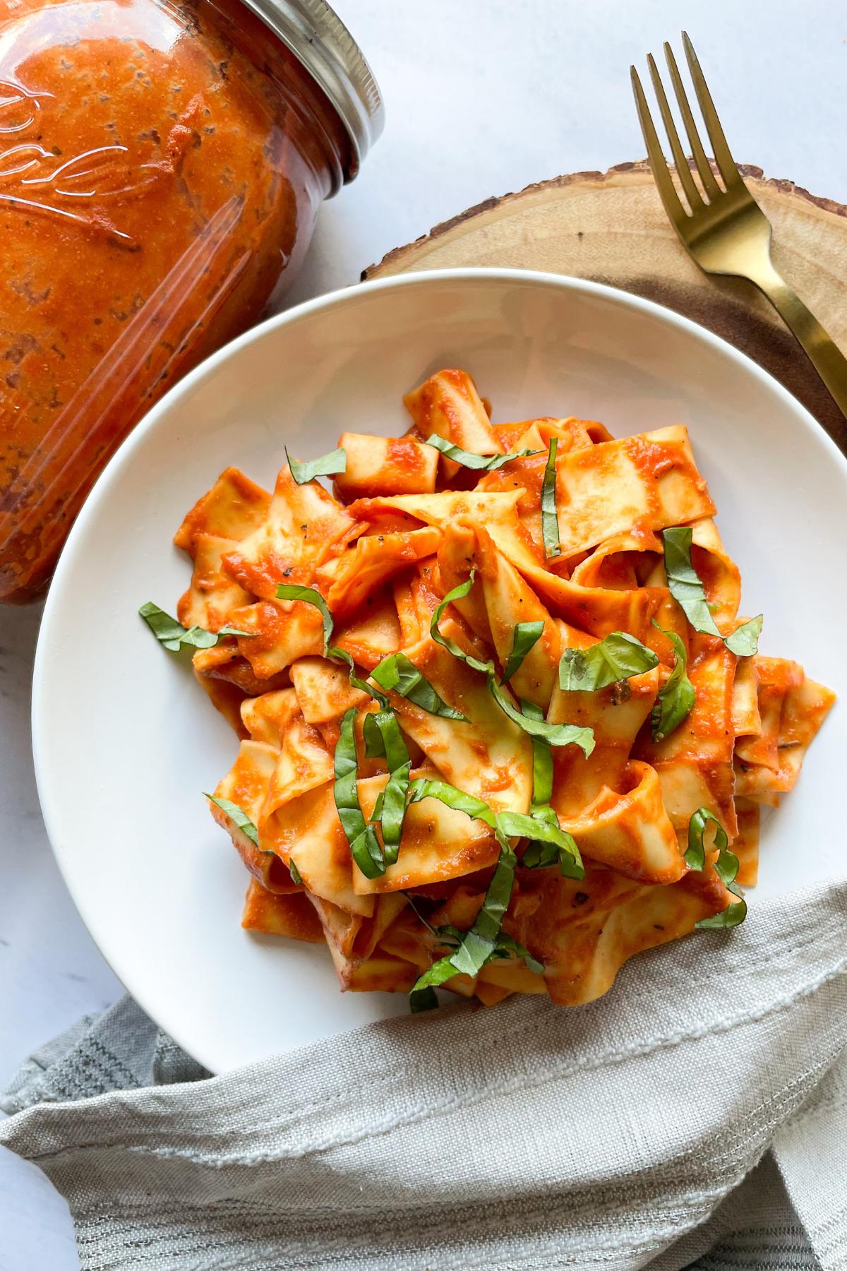 pasta with vegan tomato cream sauce on a white plate
