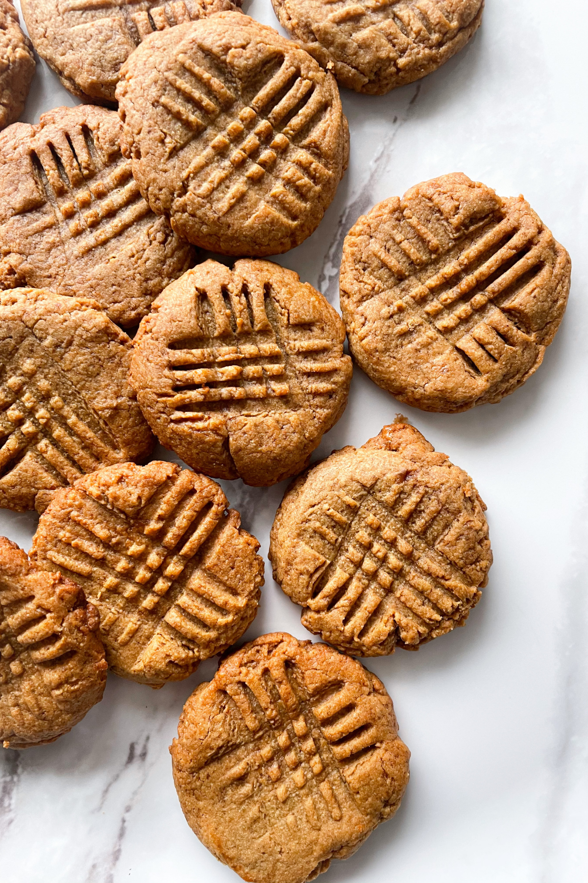 flourless peanut butter cookies on a marble background