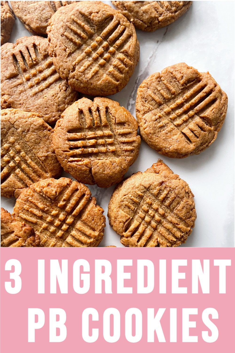flourless peanut butter cookies on a marble background with text overlay