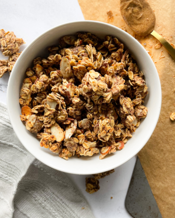 almond butter granola in white bowl