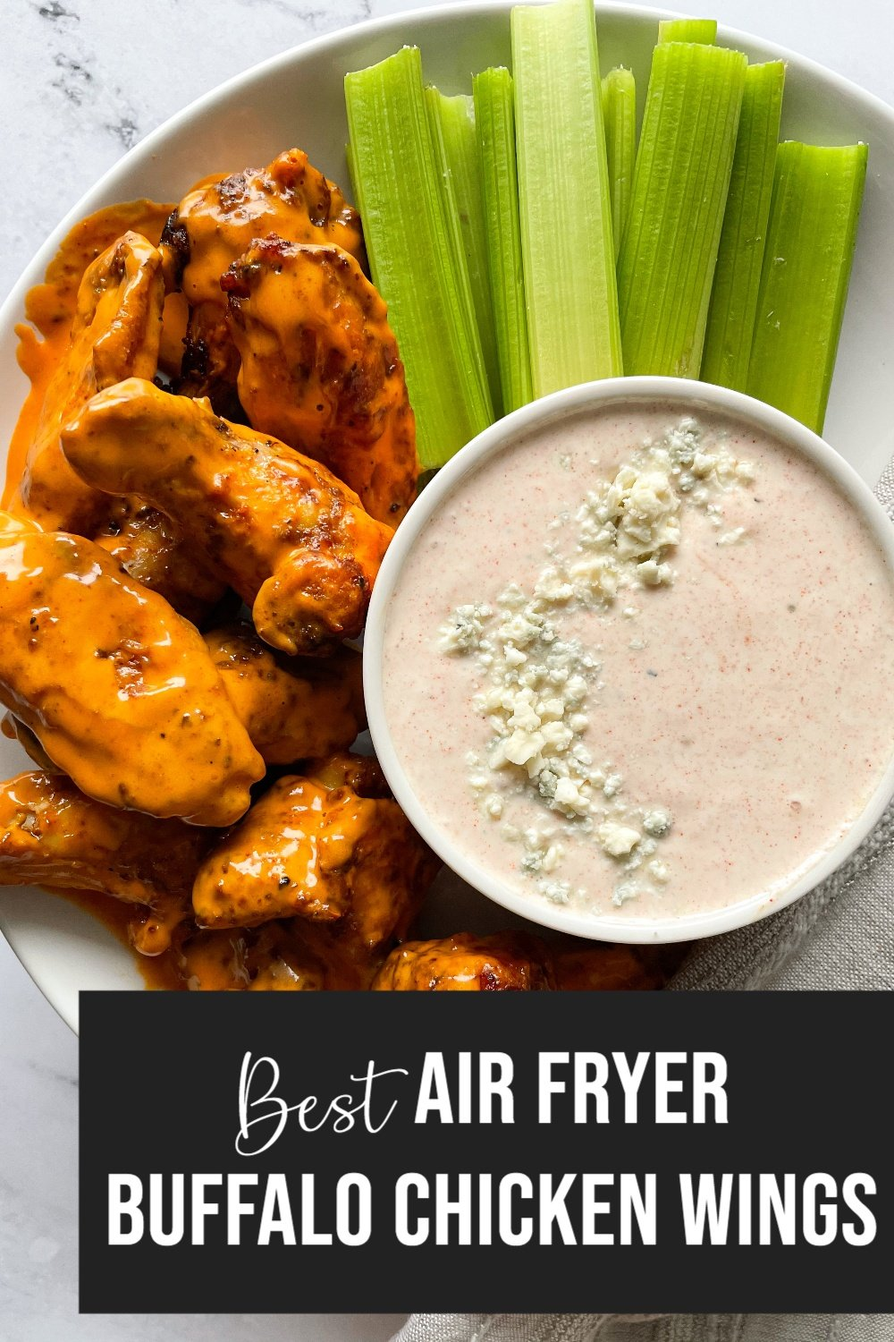 wings in plate with yogurt blue cheese dip and celery with text overlay