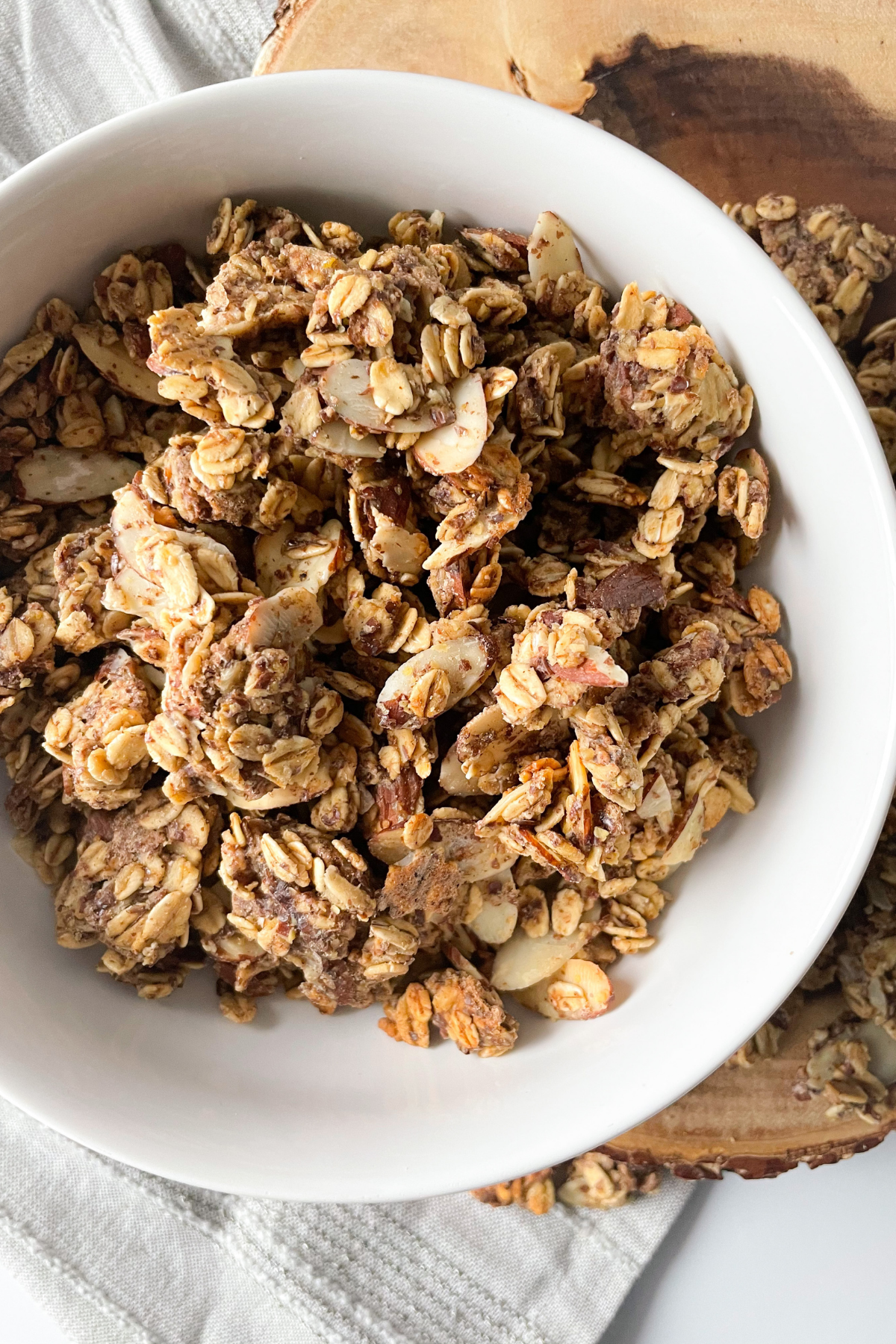 close up of almond butter granola in white bowl