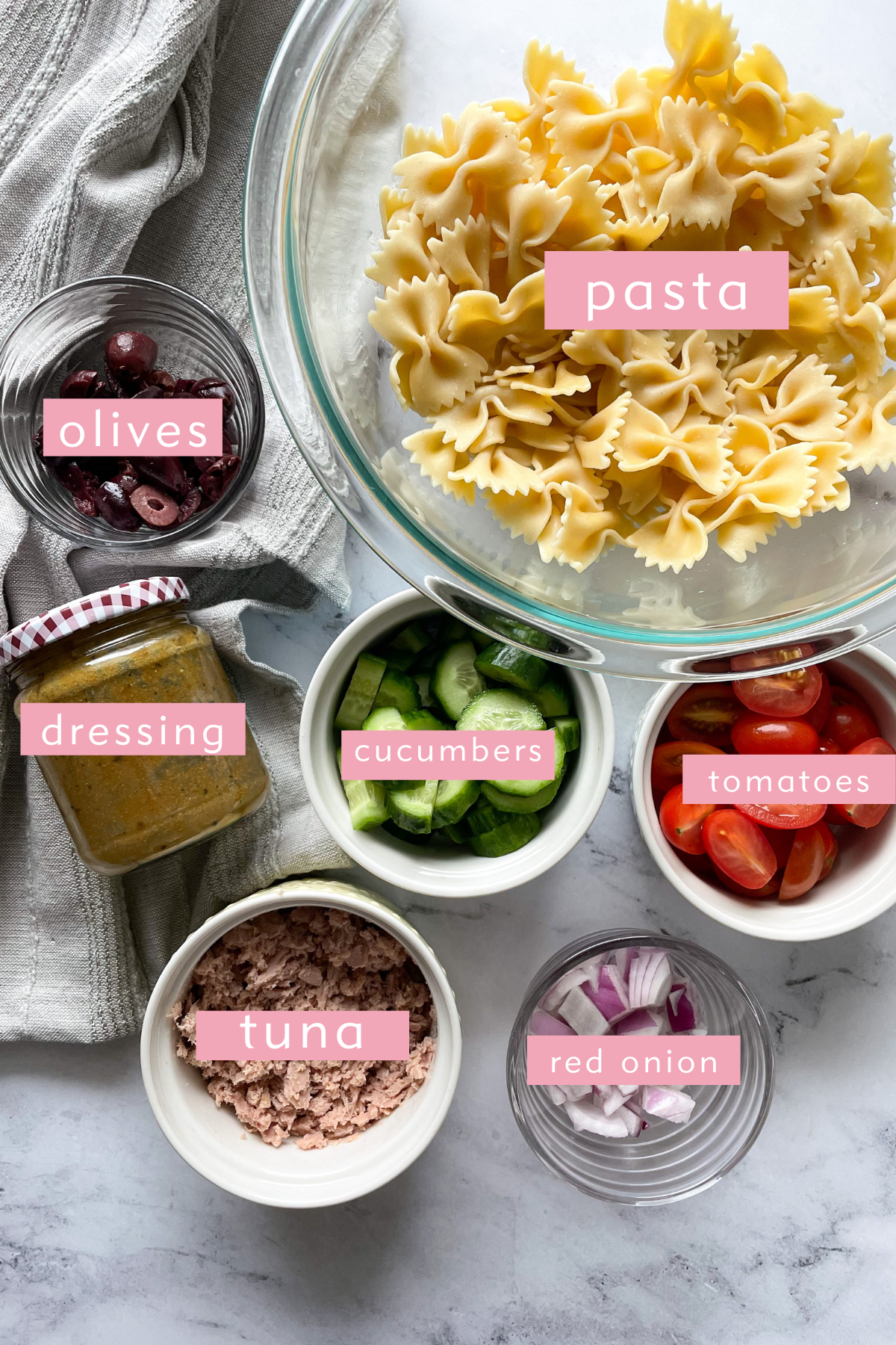 ingredients in bowls and labeled for healthy tuna pasta salad recipe