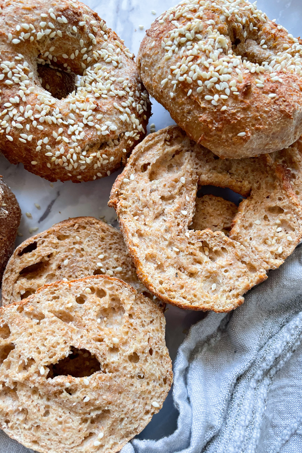 bagels on marble background and grey dish towel