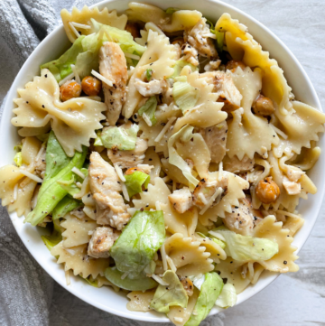 white bowl filled with chicken caesar pasta salad