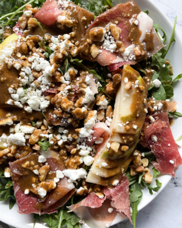 Pear and Prosciutto Salad on white plate