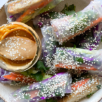 tofu summer rolls with peanut dipping sauce on plate