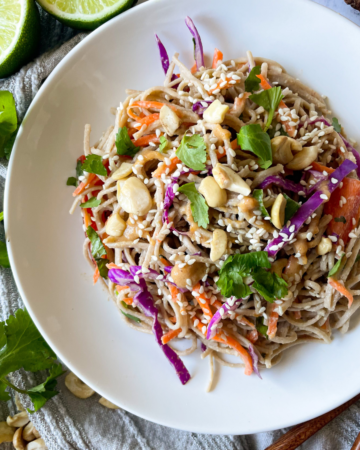 soba noodle salad on a white plate