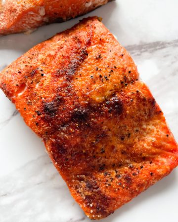 cooked salmon on marble plate