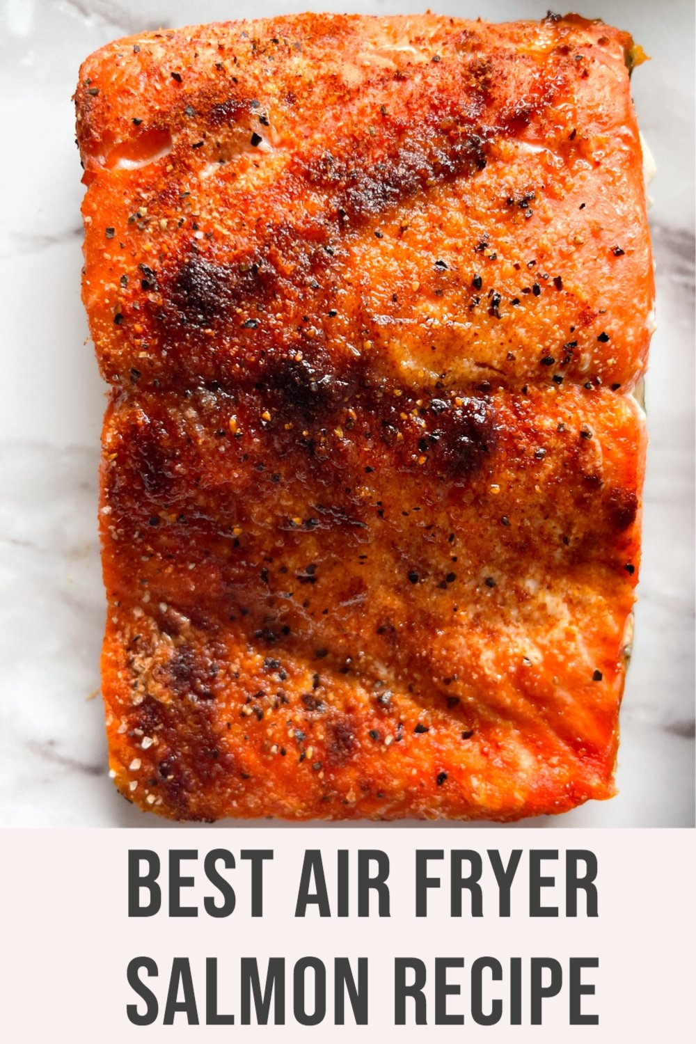 cooked salmon on marble plate with text overlay