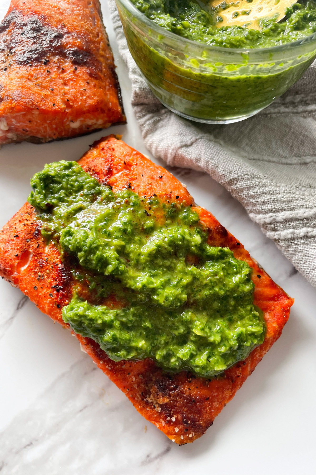 cooked salmon with cilantro sauce on top