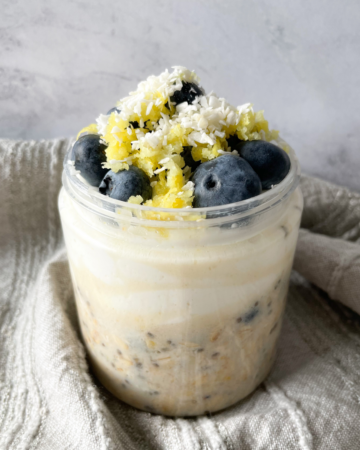 overnight oats in a jar with a grey napkin