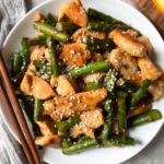 Chicken Stir Fry with Asparagus in white plate with chopsticks