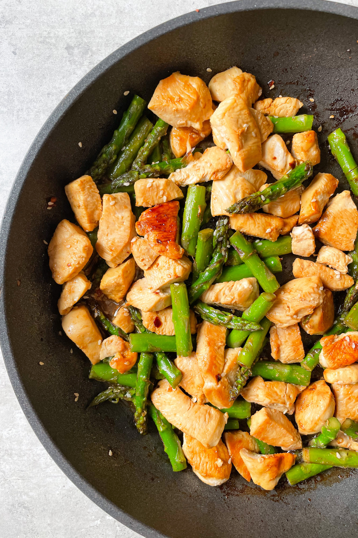 Healthy Chicken Stir Fry with Asparagus in Back Pan