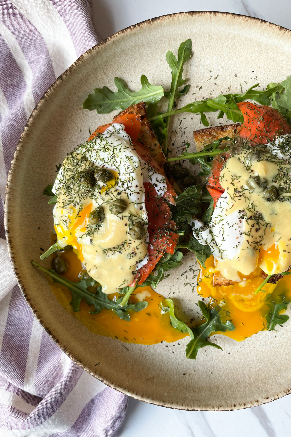 Dairy Free Lox Benedict on a Plate with Purple Dish Towel