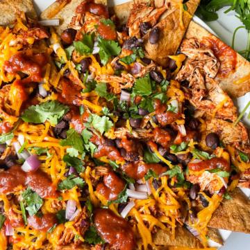 Chicken BBQ Nachos on plate with cilantro