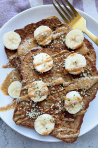 healthy french toast on plate with gold fork