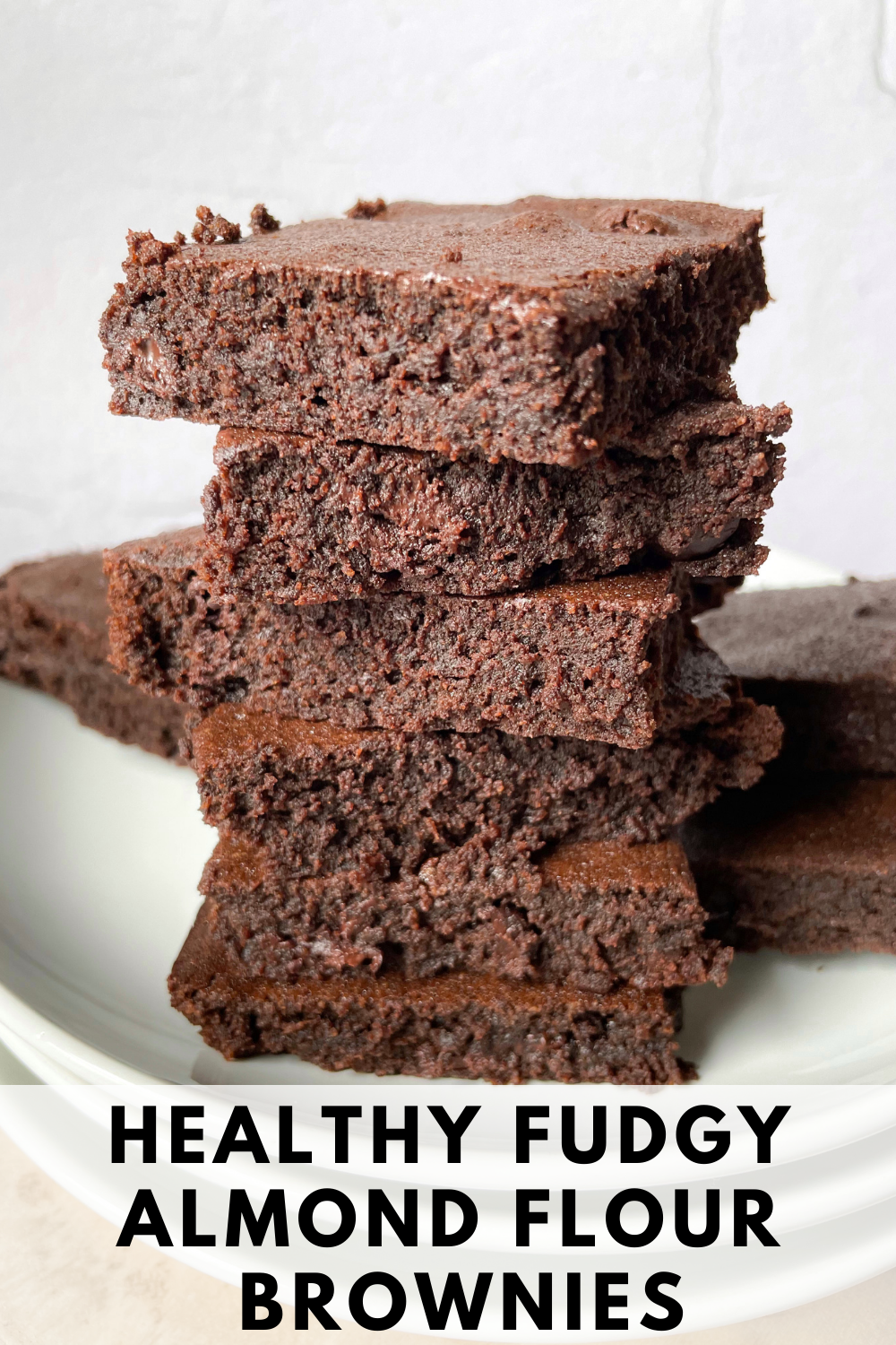 stacked almond flour brownies with text overlay