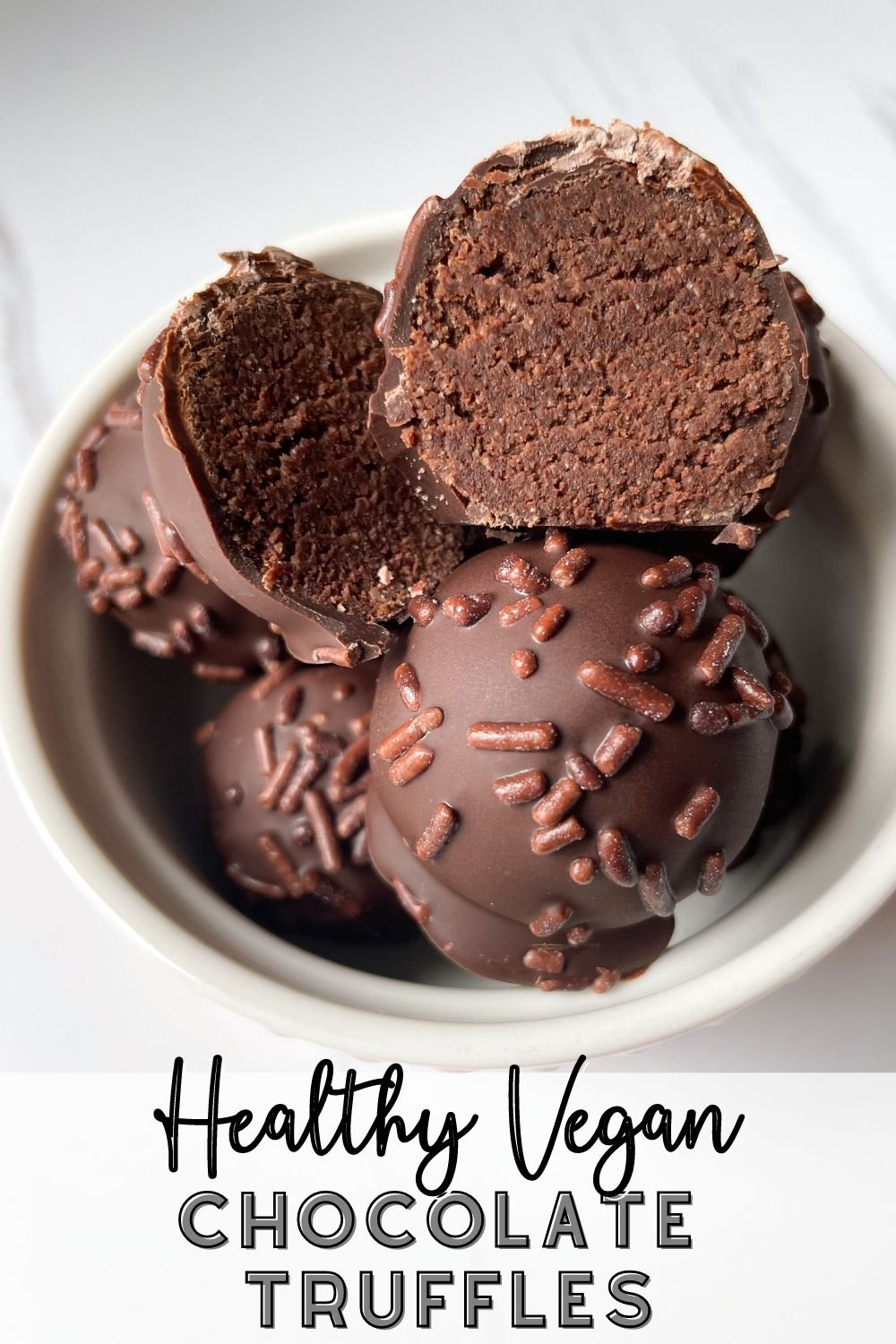 chocolate truffles in bowl on marble background