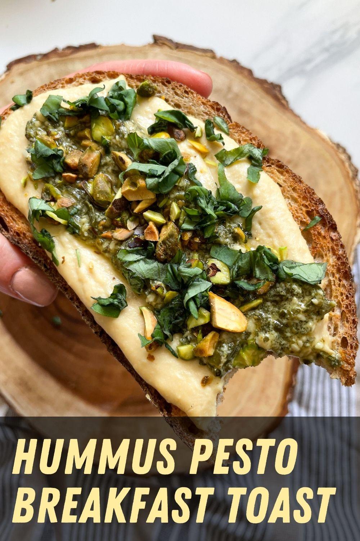 bite of sourdough hummus pesto toast