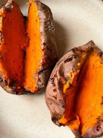 two air fryer baked sweet potatoes