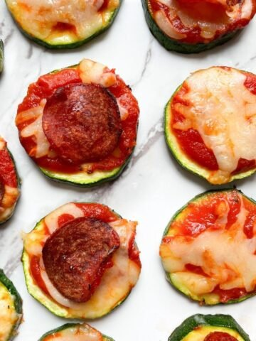 Air Fryer Zucchini Pizza Bites on marble backdrop