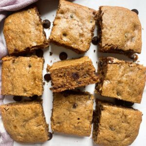 Almond Butter Banana Bread Bars on marble background with purple towel