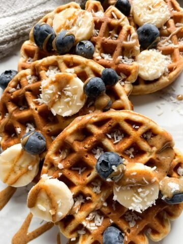 waffles on marble background and grey towel