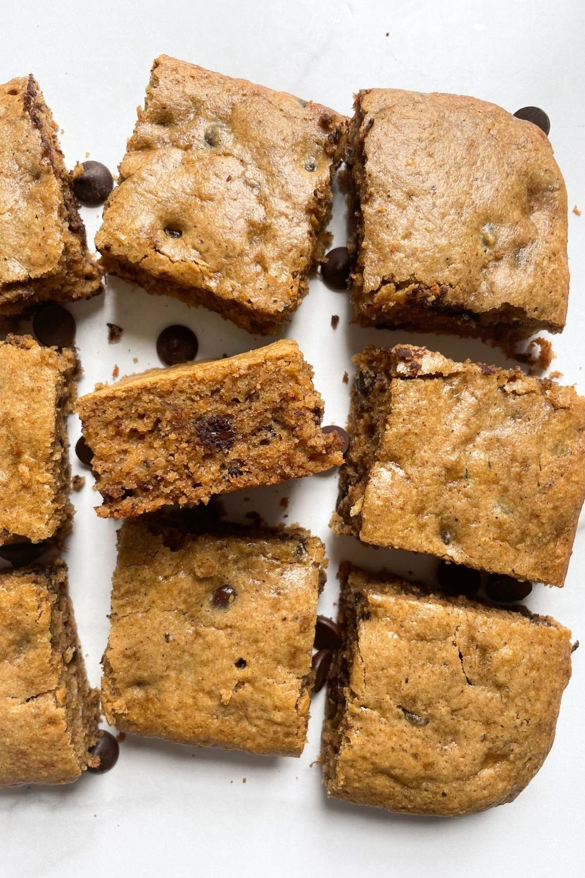 banana bread bars with chocolate chips on marble background