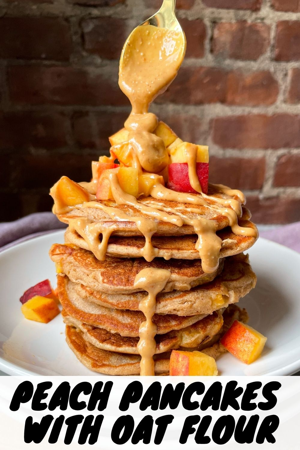 peach pancakes with spoon and peanut butter