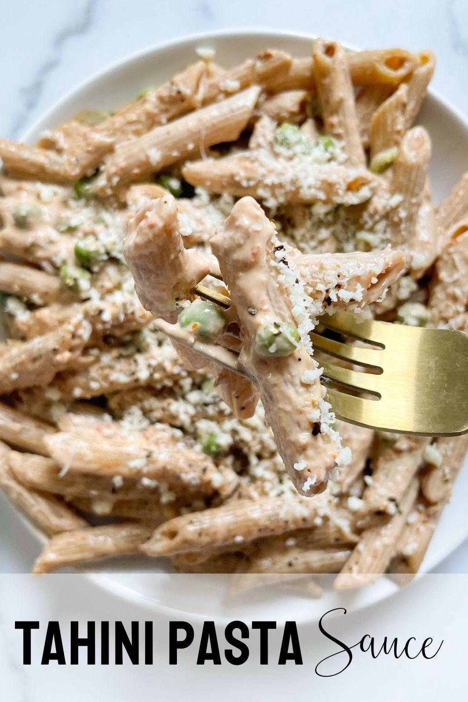 fork picking up tahini pasta