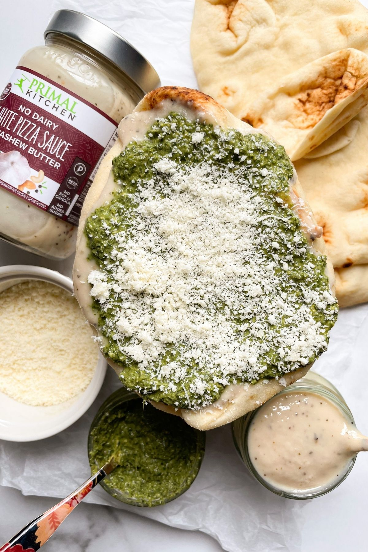 all ingredients to make naan bread pizza
