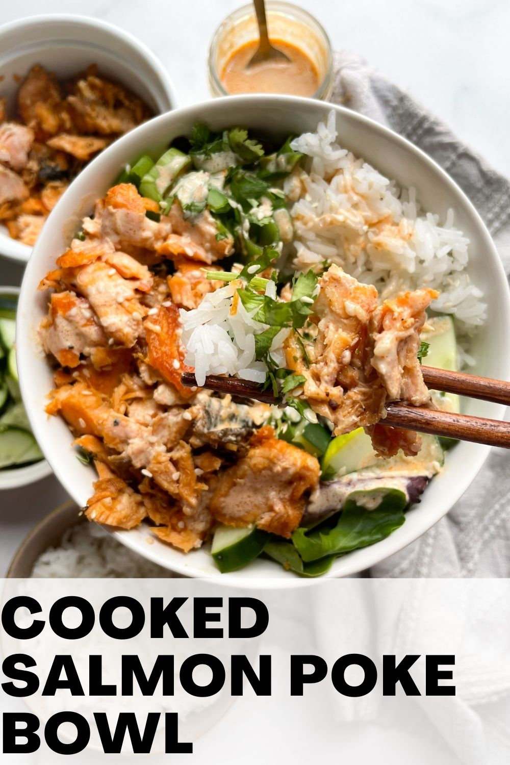 cooked salmon poke bowl with chopsticks