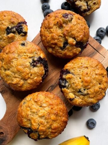 muffins on wooden board with blueberries and banana